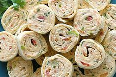 Chicken Enchilada Roll Ups  Cream cheese, diced tomatos, green onions, and maybe substitute tuna for the chicken...