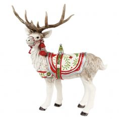Fitz and Floyd's Winter White Holiday elegant Reindeer figurine. This woodland deer warms the season hand-decorated in festive palettes of berry red, forest green and winter white. This Deer figurine is a classic for your table centerpiece!