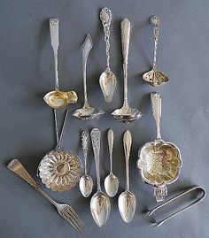 Sold for $130  Estimated Price: $150 - $250  Description: 13 sterling silver serving pieces including 2 tea strainers, 3 small ladles, sugar tongs various makers. 257 grams.