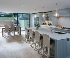 In 'Social Hub', a young couple's shared vision transformed a gloomy basement kitchen into an elegant and sociable indoor-outdoor living space for their growing family Kitchen Diner Extension, Open Plan Kitchen, Kitchen Layout, Kitchen Design, Kitchen Seating, Kitchen Dining Living, Family Kitchen, New Kitchen, Shaker Kitchen
