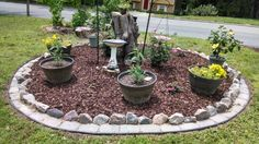 Garden around an old tree stump. Use various pots and hanging bird baths to give visual interest to your garden, as well as paver stone edging you can mow right over.