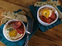 Shirred Eggs with Prosciutto, Candied Tomatoes, Parmesan-Rosemary Cream and Ciabatta Sticks from CookingChannelTV.com