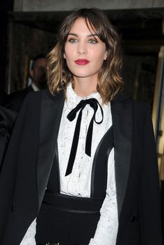 Alexa Chung Red Lipstick - Alexa wears a dark red dramatic lipstick with this black and white outfit.