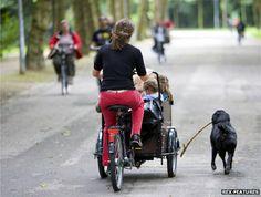 Woman with children in cargo bike