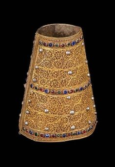 Africa | Bracelet from the Ahmara people from Ethiopia (Addis Ababa administration) | Gold gilded copper decorated with silver studs and glass stones.  It is lined with a dark green velvet | Early 20th century