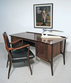 Svend Madsen rosewood desk, Denmark 1960s, with A. J. Milne rosewood chair, 1947, and oil on canvas by Henry Grub, 1921