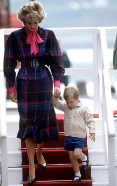 Diana and a tiny Prince William leaving the Royal Yacht, the Princess in a belted plaid jacket. via @AOL_Lifestyle Read more: https://www.aol.com/view/the-peoples-princess-diana-of-wales-a-style-transformation/?a_dgi=aolshare_pinterest#fullscreen