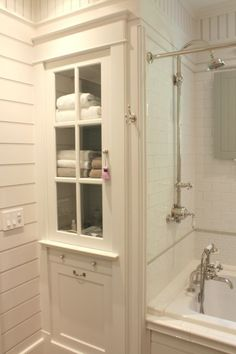 Bathroom linen cabinet and tub surround with white subway tile -- The Inn at Little Pond Farm -- photo Kelly from by Talk of the House