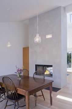 Double fireplace (modern dining room by John Lum Architecture, Inc. AIA)