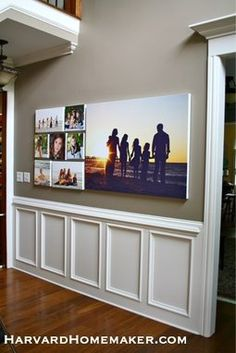 Use family pictures to create a meaningful wall gallery in your home. Here, the photos were printed on canvases. This post also shows you how to hang the gallery flawlessly the first time. #gallery #canvas #harvardhomemaker