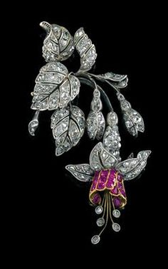 An Art Nouveau diamond and ruby fuchsia flower pendant, circa 1900