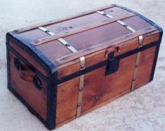 .Brass Bound Stagecoach Trunk, circa 1870s. Small pine, brass banded trunk with slats on top, brass bands and pewter colored studs. Curved top. Iron lock,