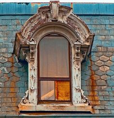 Old French Regency style window in a Mansard Roof-1800s Victorian style homes Old distressed architecture