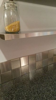 Square Stainless Steel Backsplash and open kitchen shelf | More Modern Ideas at www.StainlessSteelTile.com
