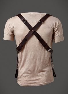 100% leather, 1 1/4' wide leather straps, back hardware detail, shackle back holster. Made in USA One size fits all.