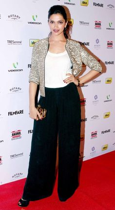 The uber stylish Deepika Padukone jazzed up this white and black combination with a sequined jacket.