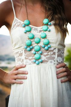 Love the detail and style of this dress! Perfectly paired with a pop of color, bubble style necklace, so my style!