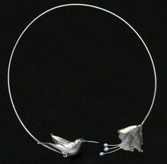 Hummingbird necklace by Xuella Arnold. Metal clay.