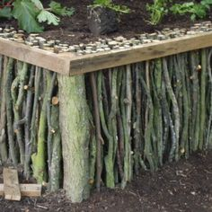 Natural wood raised garden bed.  I have a couple ideas where I might put one of these in my yard!