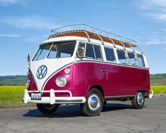 AUT 22 01 © Kimball Stock 1967 Volkswagon 13 Window Deluxe Bus Raspberry And White Front View On Pavement Raspberry Sorbet, Pavement, Cool Cars, Window, Stock Photos, Awesome, Windows, Sidewalk