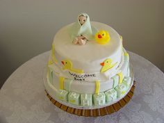 http://cakedecoratingcoursesonline.com/cake-decorating/ Baby with Duck Baby Shower Cake. Do you want your #personal #Baby #Shower #cake? - Learn Amazing #Cakes #Design Creating on http://CakeDecoratingCoursesOnline.com and Make Your Dream Baby Shower Cake Yourself