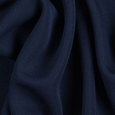 """This spectacular viscose matte jersey, from the renowned designer Ralph Lauren, has a beautiful drape and a """"dry"""" hand which is the hallmark of all fine matte jerseys. This matte fabric is of a medium weight, very slinky, semi-translucent, and contains a decent amount of 4-way stretch. Matte jersey fabrics are known to sew up into rich looking and flattering knit dresses, tops and skirts."""