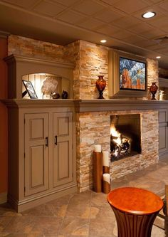 Tropical Basement Fireplace Design, Pictures, Remodel, Decor and Ideas Tv Mount Over Fireplace, Basement Fireplace, Fireplace Built Ins, Fireplace Design, Fireplace Mantle, Fireplace Remodel, Dark Basement, Fireplace Shelves, Shiplap Fireplace
