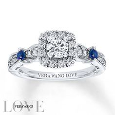 From the Vera Wang LOVE Collection, this eye-catching engagement ring features a 1/3 carat round center diamond framed by accent diamonds. The ring's diamond-lined band features two round sapphires, a signature of the collection and a symbol of faithfulness and everlasting love, that add color and sparkle. Intricate milgrain detailing completes the exquisite design. Set in 14K white gold with 3/4 carat total weight of diamonds, the engagement ring is a brilliant beginning to you...