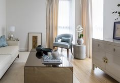 Contemporary living room in luxury modern apartment. Interiors by boutique interior design studio- Anouska Tamony Designs