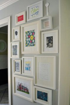 Gallery wall...white frames, colorful art