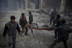 Spot News first prize stories: 'Aftermath of Airstrikes in Syria' by Sameer Al-Doumy.  October 30 2015. Smoke rises from a building following reported shelling by Syrian government forces in Douma Syria. Douma a rebel-held city in a suburb of the capital Damascus lies in the opposition bastion area of Eastern Ghouta and has been subject to massive regime aerial bombardment. The area has also been under a crippling government siege for nearly two years as part of a regime attempt to break the…