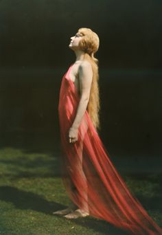 Portrait of a woman draped with red silk. PHOTOGRAPH BY FRANKLIN PRICE KNOTT, NATIONAL GEOGRAPHIC