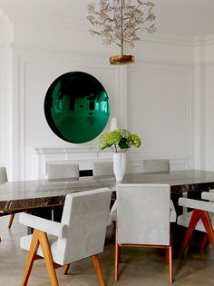 Modern dining room with coloured green concave mirror