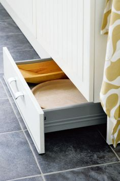 Kickboard storage - brilliant use of wasted space. Speak to cabinet maker about this and see if it's possible to do the kicks with pullouts but will hate handles on the kick so ask about push releases.  But would be great for storage.