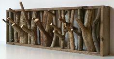 DIY Twig/branch hanger - what about with driftwood? Now I have an idea for my daughter's beach-themed bedroom!