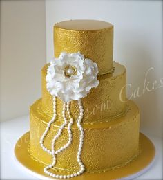 Gold and pearls wedding cake