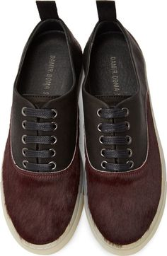 Silent, Burgundy Calf-Hair & Leather Sneakers by Damir Doma. Calf-hair and leather low-top sneakers in burgundy and black. Round toe. Black lace-up closure. Embossed logo at tongue. Textile pull-tab at heel collar with embroidered logo in white.  http://www.zocko.com/z/JF14z