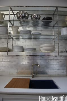 Our 2012 Kitchen of the Year by designer Mick de Giulio gets its shine from a white goldleaf tile backsplash by Ann Sacks.   - HouseBeautiful.com