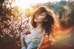 In spring... emotion portrait in sunset... sunshine in the hair... with trees with flowers - photo: Marketa Novak  model: Helena Garneková