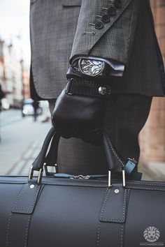 Arnold Son Skeleton TB88. - love his look, the gloves and the bag set it off…                                                                                                                                                                                 More