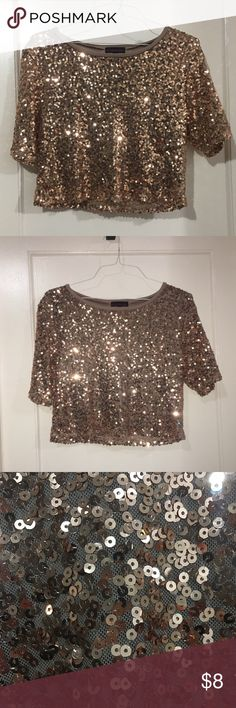 Cute Sequin top ✨ Slightly cropped sequined top from material girl. Has a boxy fit and the material is delicate. The color is a mixture of bronze and orange. Gorgeous top, perfect for the winter season. Would look best while wearing a bun and rocking blue jeans w/ nude heels. Not recommended for ppl who usually have their hair down (it will get caught onto the sequins). Offers welcomed and questions encouraged. 🌼 Material Girl Tops
