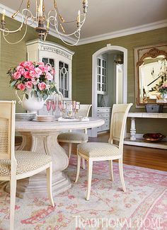 A stone pedestal table anchors the pretty-in-pink dining room, which opens to the entry hall. - Photo: Kip Dawkins / Design: Janie Molster