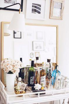 Mirror behind the bar - Alaina Kaczmarski's Lincoln Park Apartment Tour Bar Cart Styling, Bar Cart Decor, Canto Bar, Bar Tray, Feminine Decor, Interior Decorating, Interior Design, Decorating Ideas, Bars For Home