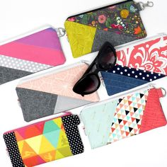 New item alert! Get ready for spring with a new pouch for your sunglasses. Cotton fabric zip pouch is padded and lightly quilted. Comes with a simple metal ring or a snap hook to go on your keychain. Each one is a work of art!