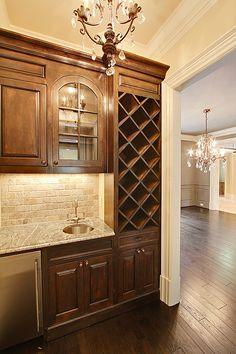 nice bar area {like the tall wine storage} for the basement