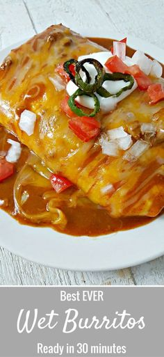 Best ever Smothered Wet Burritos Recipe - These beef and bean wet burritos are smothered with red sauce and melted cheese. Top with your favorites such as guacamole, sour cream, lettuce, onion, and tomatoes. Ready in just 30 minutes. #WetBurritos #dinner #Mexican #BestRecipes #30MinuteMeal #beef Mexican Dishes, Mexican Food Recipes, Beef Recipes, Cooking Recipes, Ethnic Recipes, Cooking Tips, Mexican Desserts, Freezer Recipes, Freezer Cooking