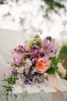 Peach and lavender bouquet.  #wedding #flowers #peach #bridal #bouquet