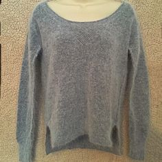 Gray rabbit fur sweater Soooooo soft - this is a gorgeous gray sweater made with a nylon / rabbit hair / wool blend.  Goes great with jeans or a black skirt and heels.  Great condition - size extra small. Moda International Sweaters
