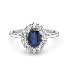 A sapphire and diamond cluster ring set with an oval sapphire weighing surrounded by a cluster of round brilliant cut diamonds of total weight, G colour, VS clarity, all set in white gold claw setting. Diamond Cluster Ring, Sapphire Diamond, Clarity, Diamonds, White Gold, Engagement Rings, Colour, Jewels, Gemstones