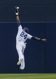 San Diego Padres center fielder Cameron Maybin can't make the catch on a ball hit by Colorado Rockies' Jordan Pacheco during the first inning of a baseball game Tuesday, May 8, 2012 in San Diego. Pacheco got a double on the play. (AP Photo/Lenny Ignelzi)